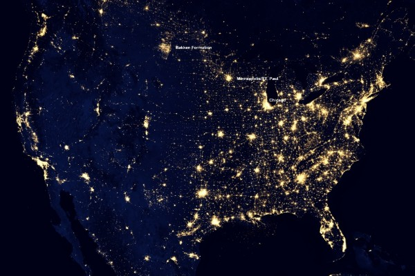 Satellite photo of US at night. Flares from Bakken shale wells in North Dakota